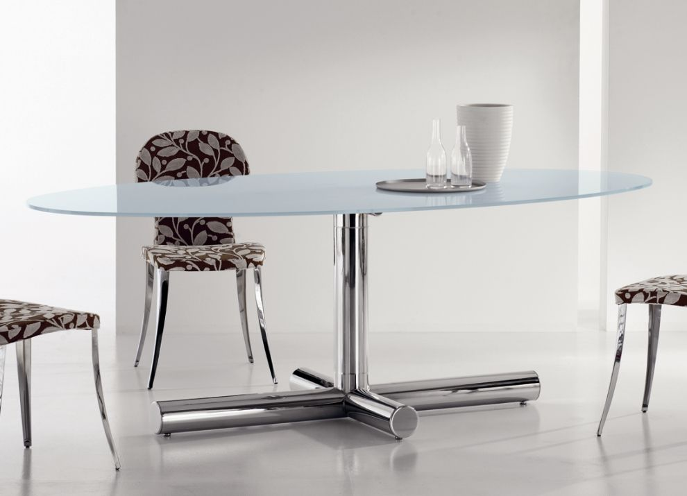 Oval Glass Dining Table Is A Proper Choice For Adorning Your Dining Room.  It Looks