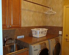 Rochester Fireplace, Powder Room, and Laundry Room. traditional laundry room