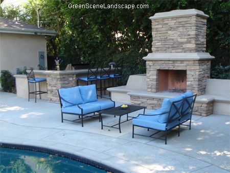 Great outdoor kitchen and bar area with separate fireplace seating on kitchen countertop seating, kitchen bar seating, kitchen cabinets seating,