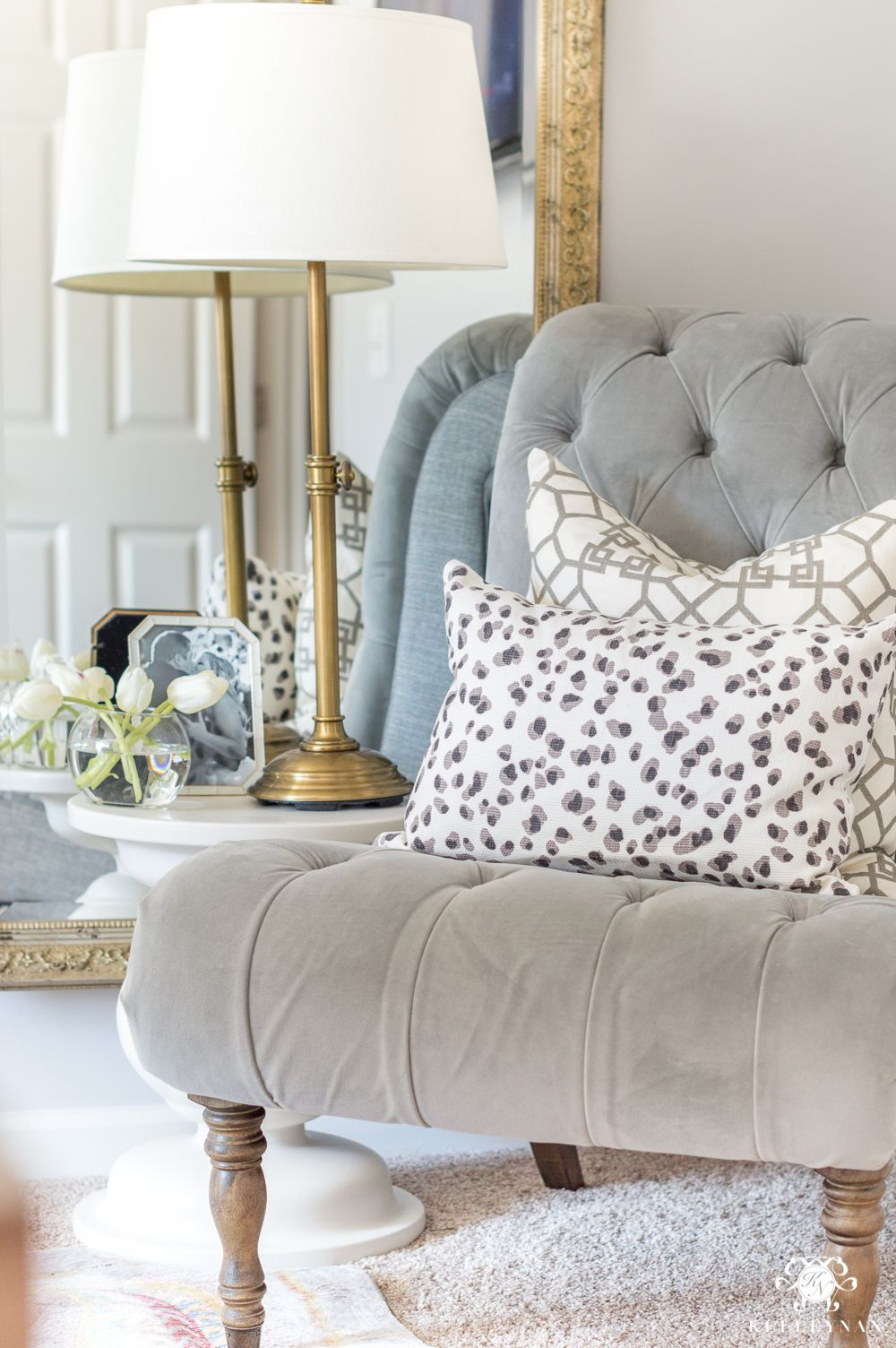 Tufted Gray Slipper Chair With Layered Patterned Pillows
