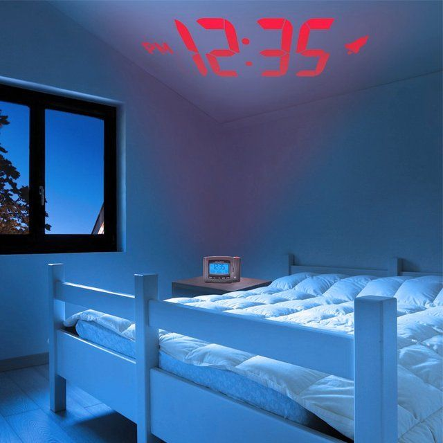 Wake up to the time projected in large digits on your wall or ceiling. The alarm clock features an easy-to-read backlit screen with time, month / date, day of week and indoor temperature, a loud alarm clock and snooze button. Bright blue backlight. •Electric-power with battery backup in case of power failure. Includes: Projection clock, AC power adapter, instruction manual. Please allow 1-2 weeks for shipping.