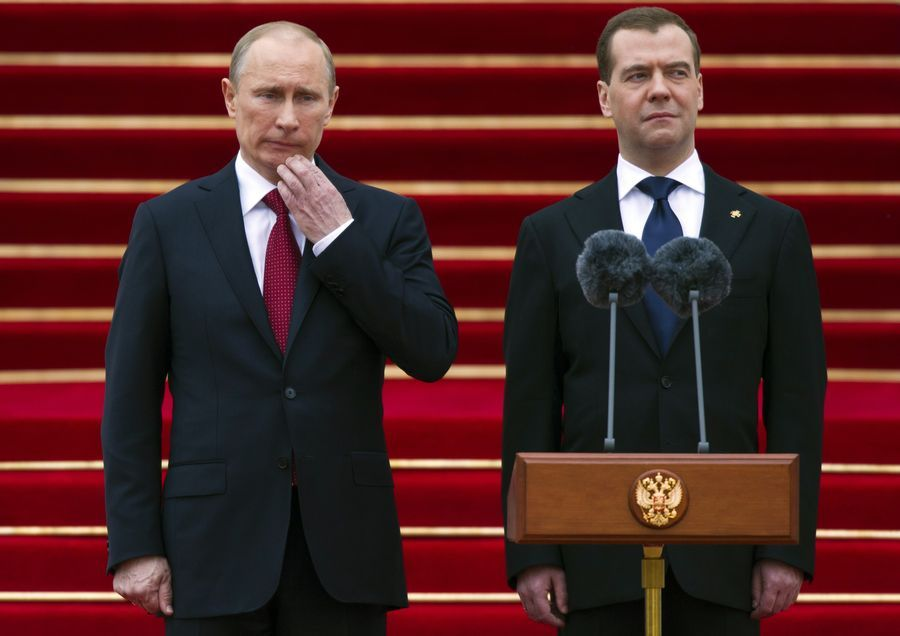 New Russian President Vladimir Putin, left, and former president Dmitry Medvedev watch honour guards marching during an inauguration ceremony in Cathedral Square at the Kremlin in Moscow. (Reuters)
