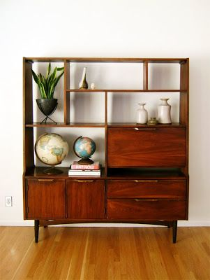 mid century modern i own this it is perfect in my dining room the lower left cabinet holds my wine in a little rack and the upper right holds the bar