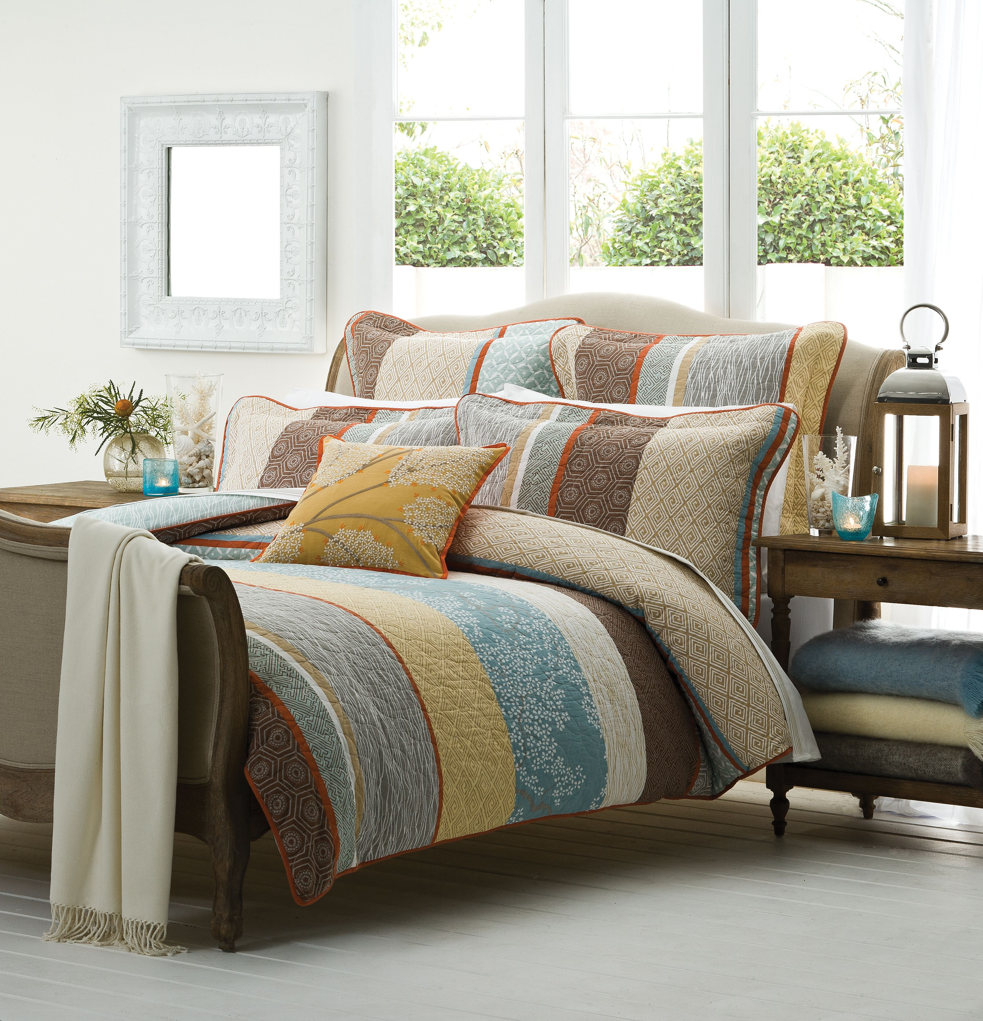 Warm ochre hues and soft blossom prints evoke understated