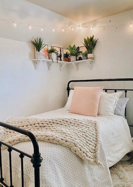 This was such a fun DIY and I share all the steps in this post so you can make one too.   The faux summer plants arranged on the shelf create the perfect warm-weather decor vibe for this boho-glam bedroom.     #prideinthemaking #handmadewithjoann #BedroomDecoratingTips