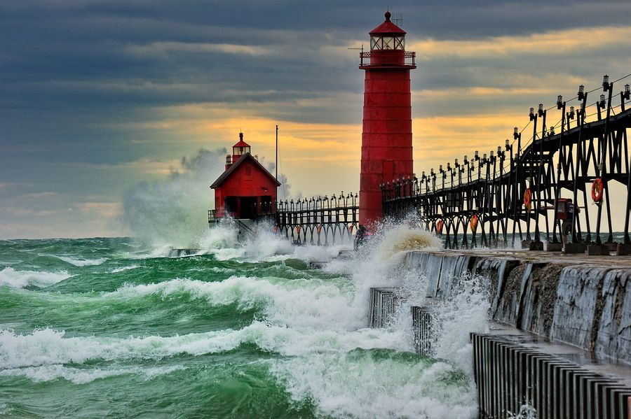 """""""September Gale"""" Grand Haven Breakwater Lighthouse is located in the harbor of Grand Haven, Michigan by John McCormick"""