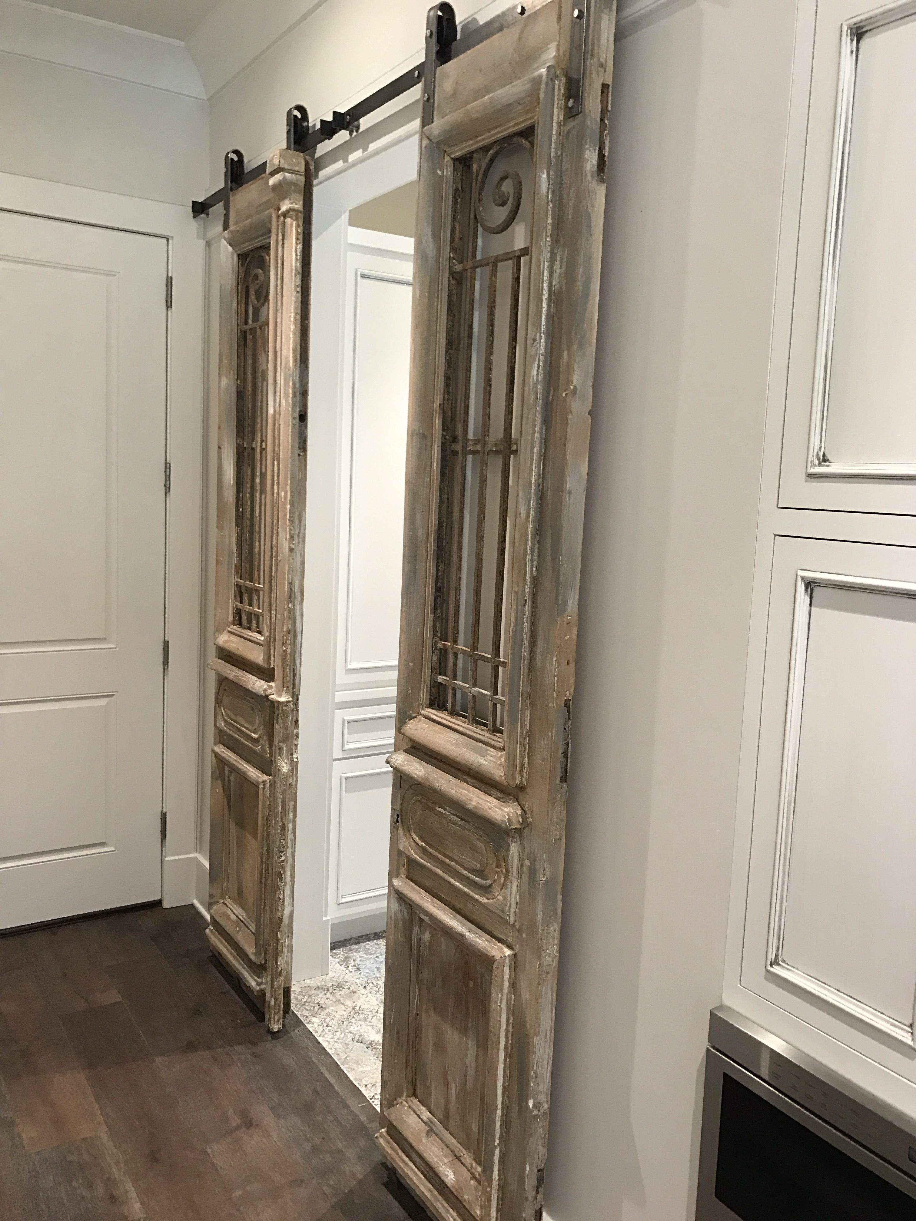 Our Antique French Iron Doors Hung Barn Door Style Laundry Room