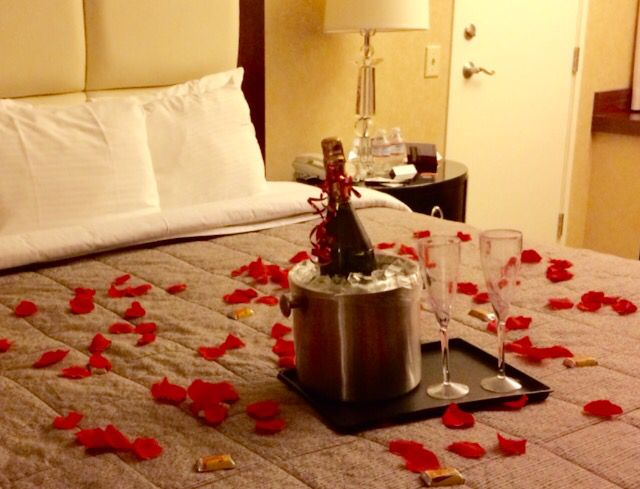 Bring Rose Pedals And Champagne For Your Hotel Room Set Up While Your Partner Is In The B Romantic Room Decoration Romantic Hotel Rooms Romantic Room Surprise