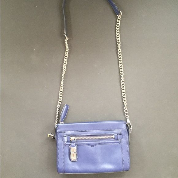 NWOT Rebecca Minkoff crossbody This deep blue mini crossbody from Rebecca Minkoff is gorgeous and perfect if you just need to take the essentials when you're on the go! (Color is best represented in the third picture) It is in perfect condition and will make a great addition to your closet! #leather #blue #purse #rebeccaminkoff #nwot #new #crossbody open to reasonable offers! Rebecca Minkoff Bags Crossbody Bags