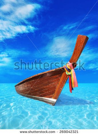 brown wooden boat in the blue sea