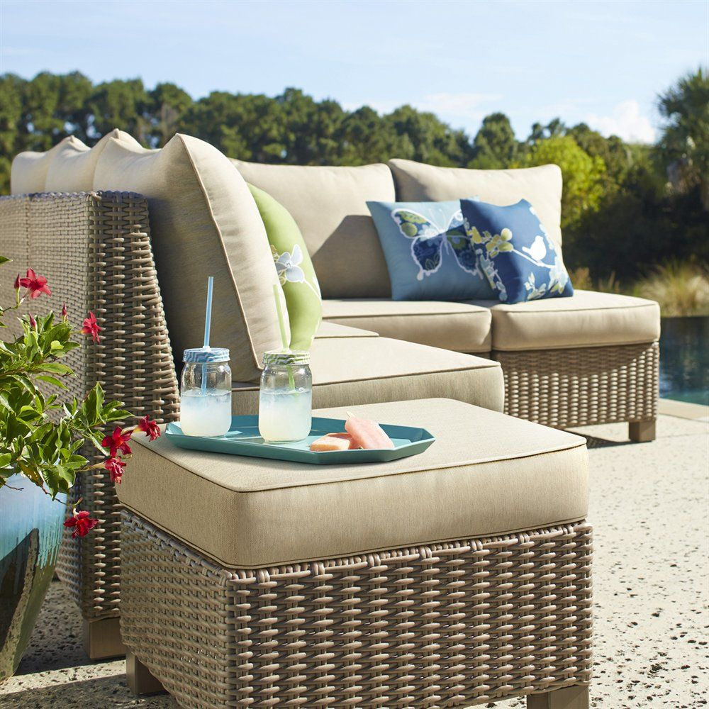 Crafted with handwoven polyethylene outdoor wicker, this
