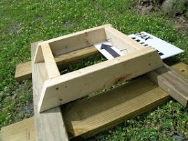 """The basement: simple 2x4 construction. ¼"""" aluminum channel is screwed to the inner sides to allow for a simple catchment drawer made from corrugated plastic. The screws above that support the screened floor."""