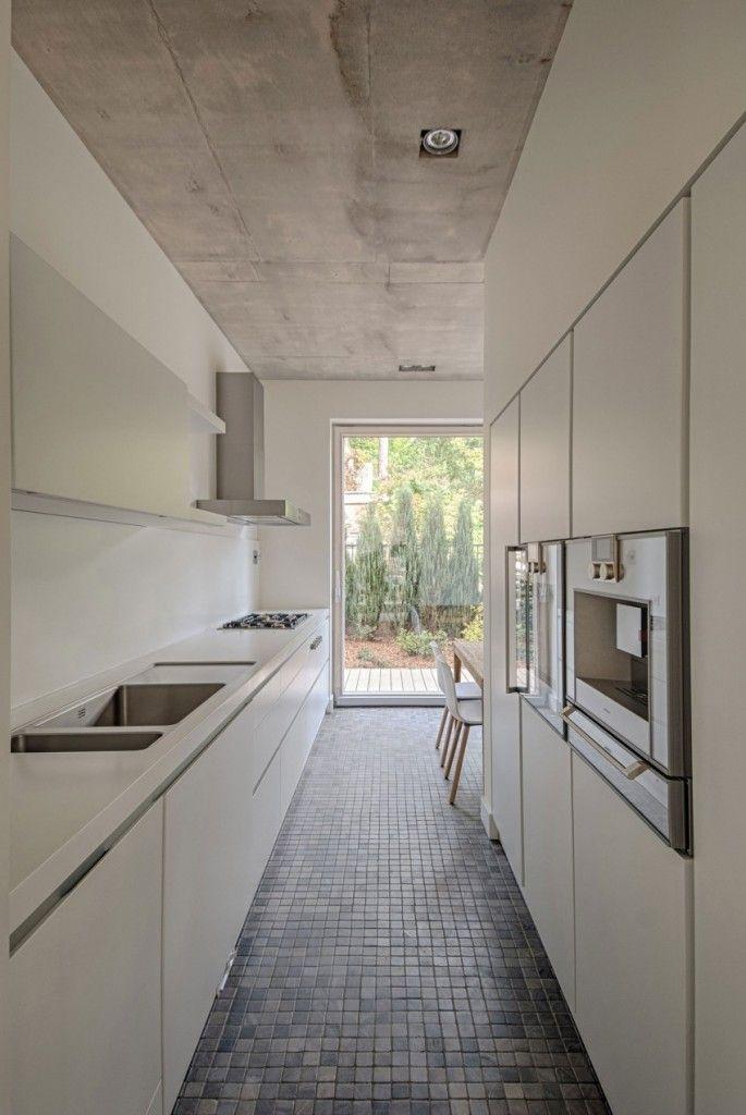 House in Vilnius by Aketuri Architektai #whitegalleykitchens