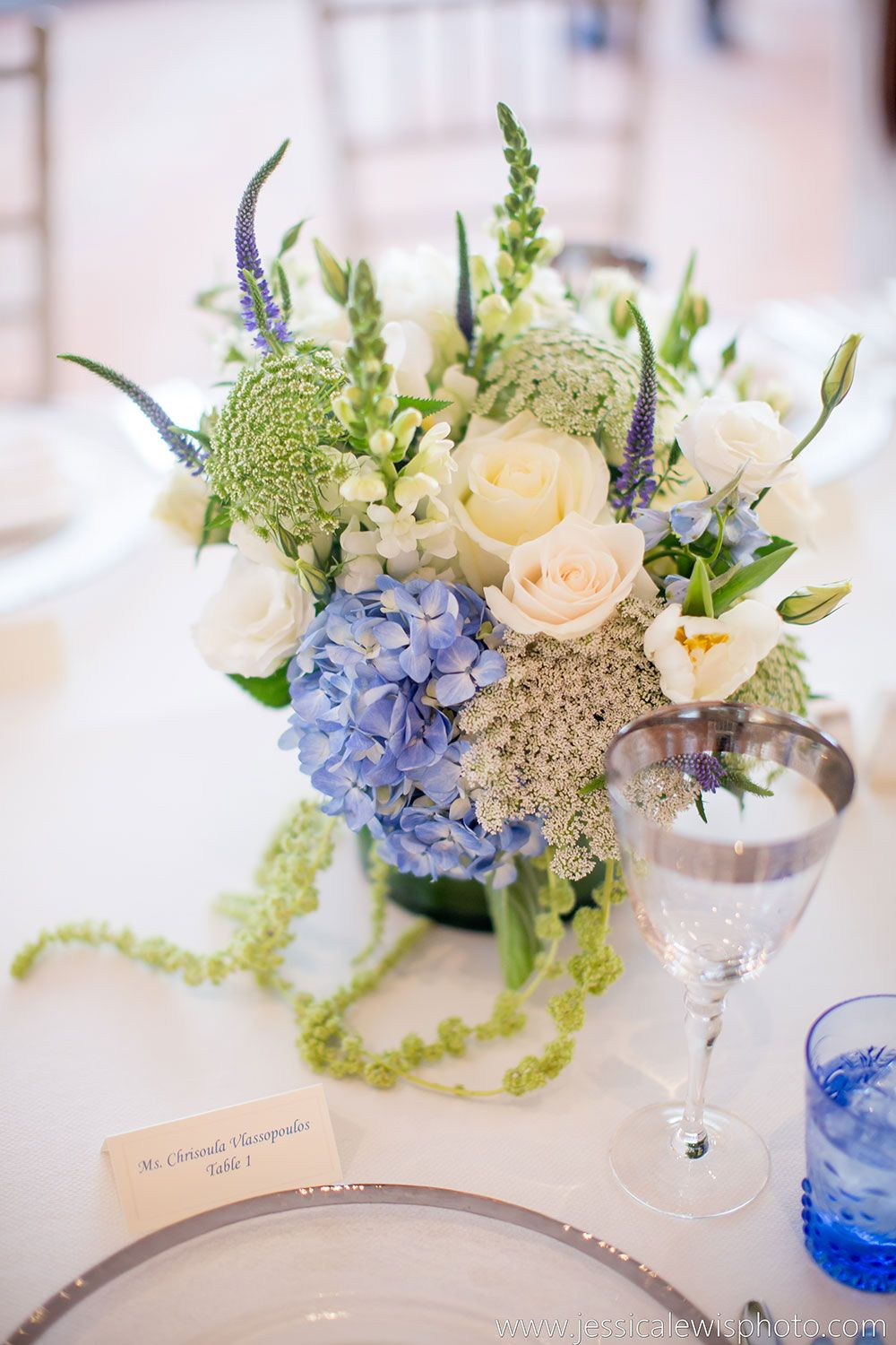 Soft blues and creamy whites. Luxurious hydrangea, Queen Anne's lace, Veronica, ruffled roses along with amaranthus.  Image: Jessica Lewis Photography