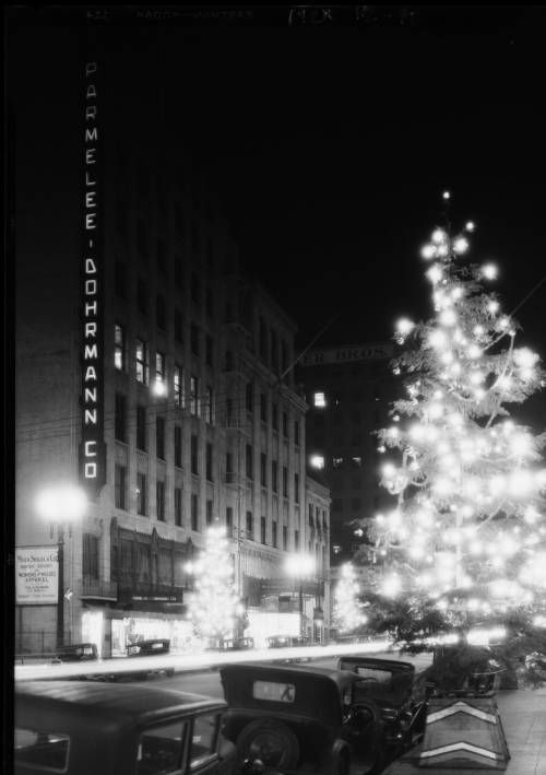 """Christmas tree at night in street, South Flower Street, Los Angeles, CA, 1928 [image] :: Christmas tree at night in street, South Flower Street, Los Angeles, CA, 1928 :: """"Dick"""" Whittington Photography Collection, 1924-1987. http://digitallibrary.usc.edu/cdm/ref/collection/p15799coll170/id/9863"""