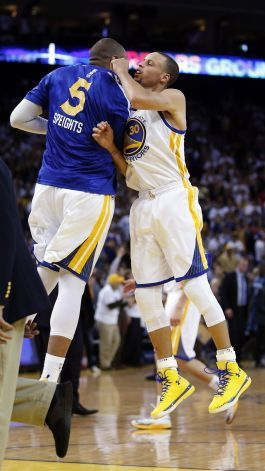 c08d54708a94 Stephen Curry (30) celebrates with Marreese Speights (5) after Curry hit a  three-point shot in the second half. The Golden State Warriors pl.
