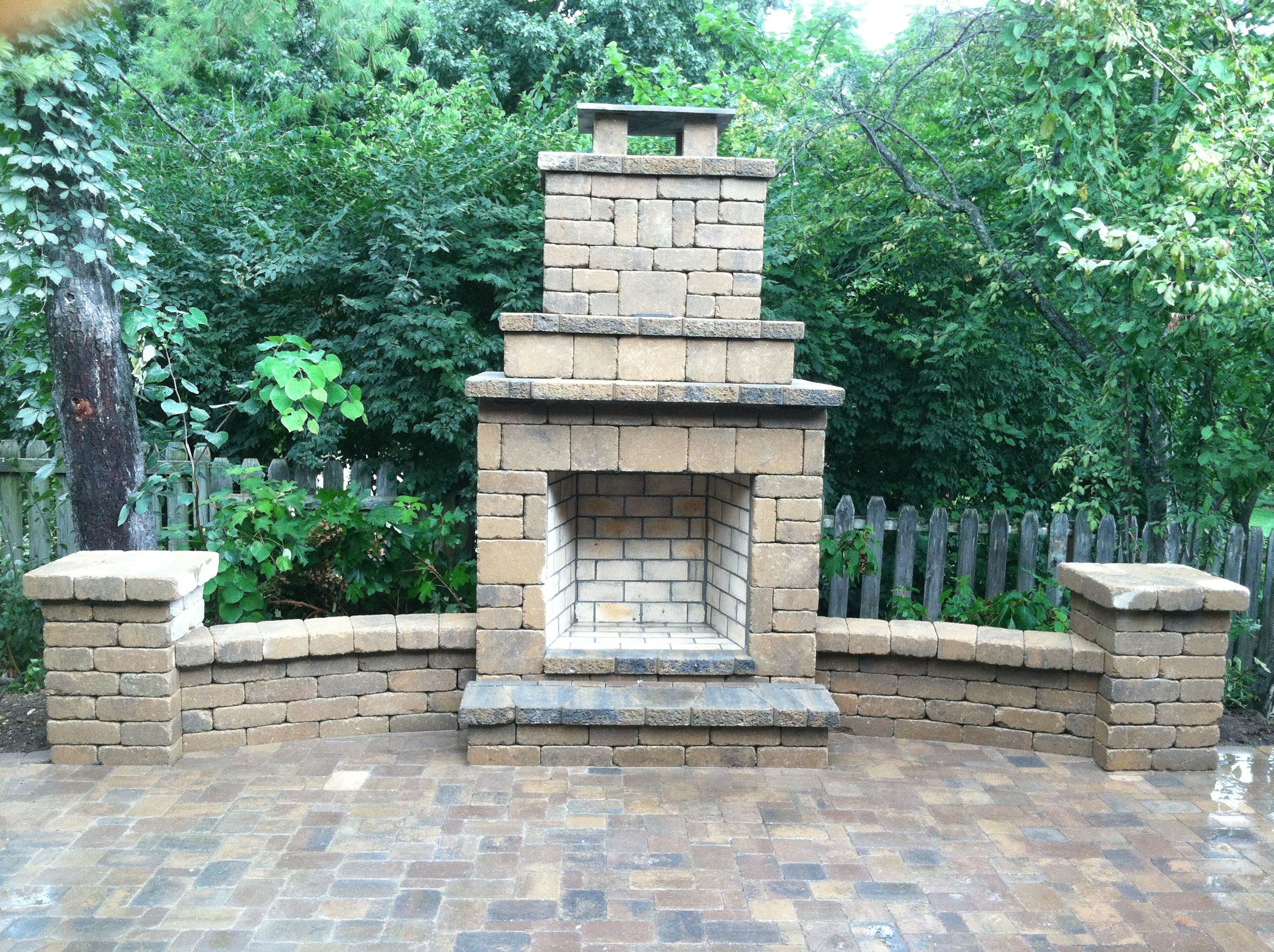 Outdoor fireplace with wing walls, columns and brick paver ...