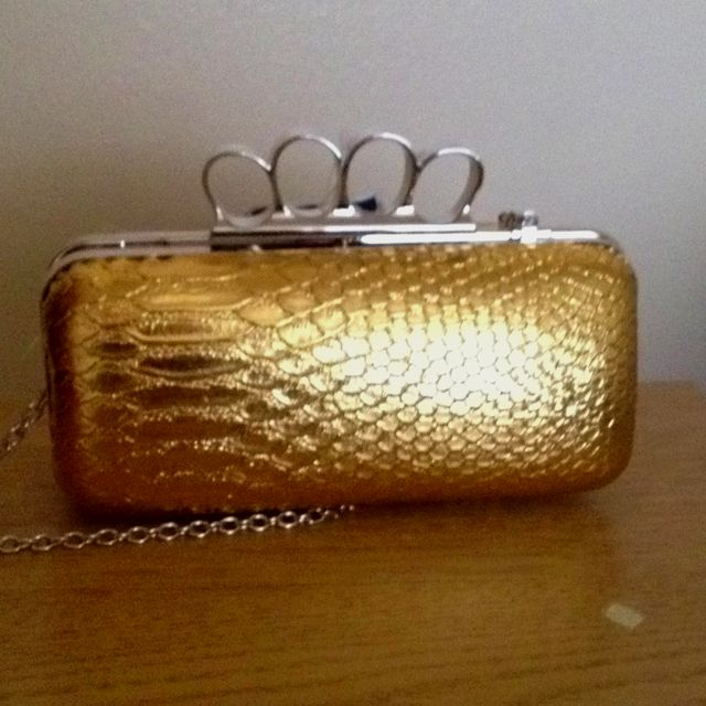 Brass knuckle purse