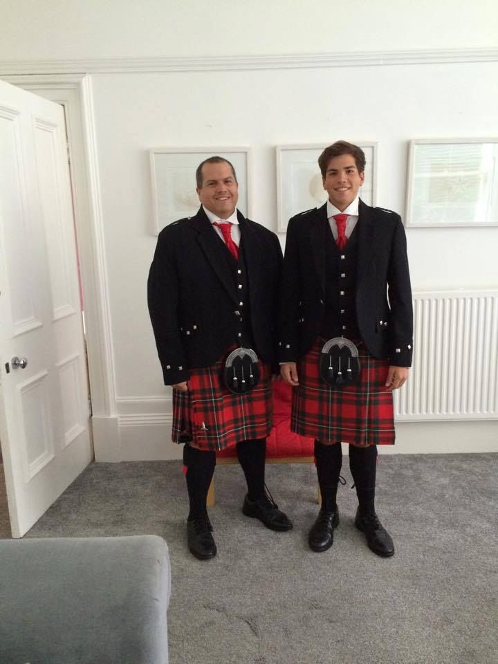 These guys came all the way from Puerto Rico for a wedding in Bonnie Scotland! They are both wearing the Red MacGregor tartan kilts.