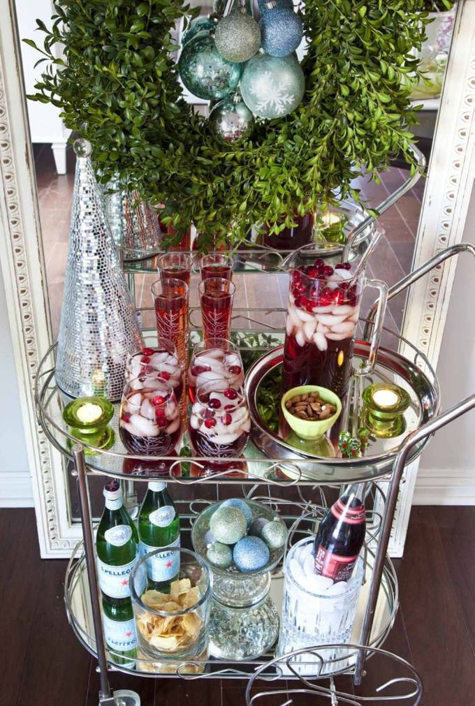 Styled by Emily Ruddo.  Christmas Holiday bar cart and wreath. Photographed by Meghan Beierle-O'Brien. #christmas #holiday decorating #barcart