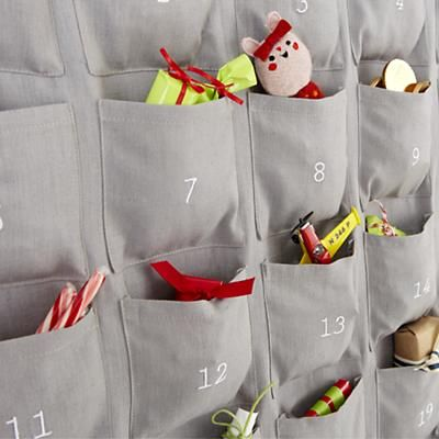 Kids' Holiday Decor: Kids Numerical Calendar in Calendars. Each pocket is 4 inches by 4 inches. Land of Nod $35.00. Plain enough to use for any holiday count-down or vacation/event countdown