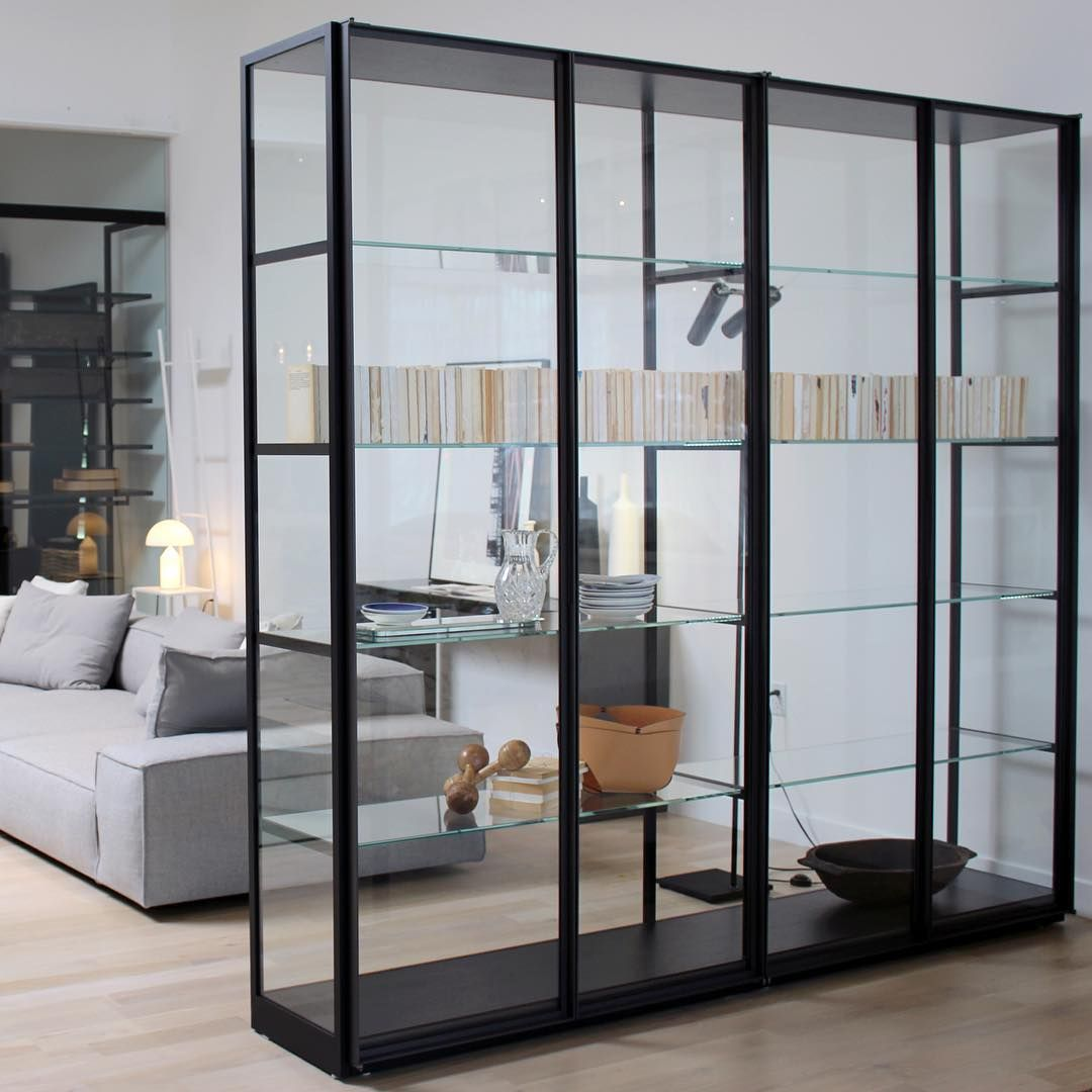 the ex libris cabinet by pierolissoni for porro features tempered glass doors and sides with. Black Bedroom Furniture Sets. Home Design Ideas
