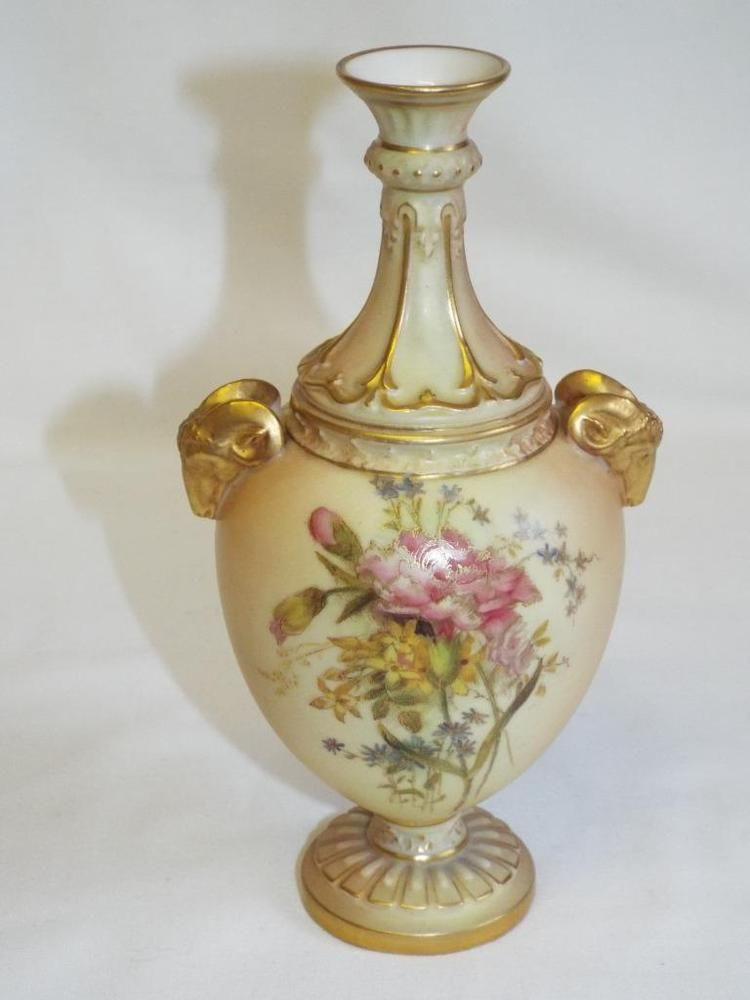 Lovely antique Royal Worcester handpainted vase with gilded rams head handles.