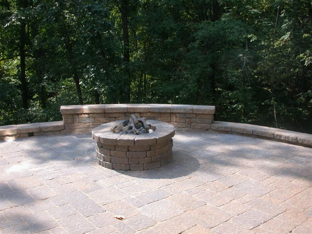 Seating wall around a fire pit Basile Installed Seating Walls and