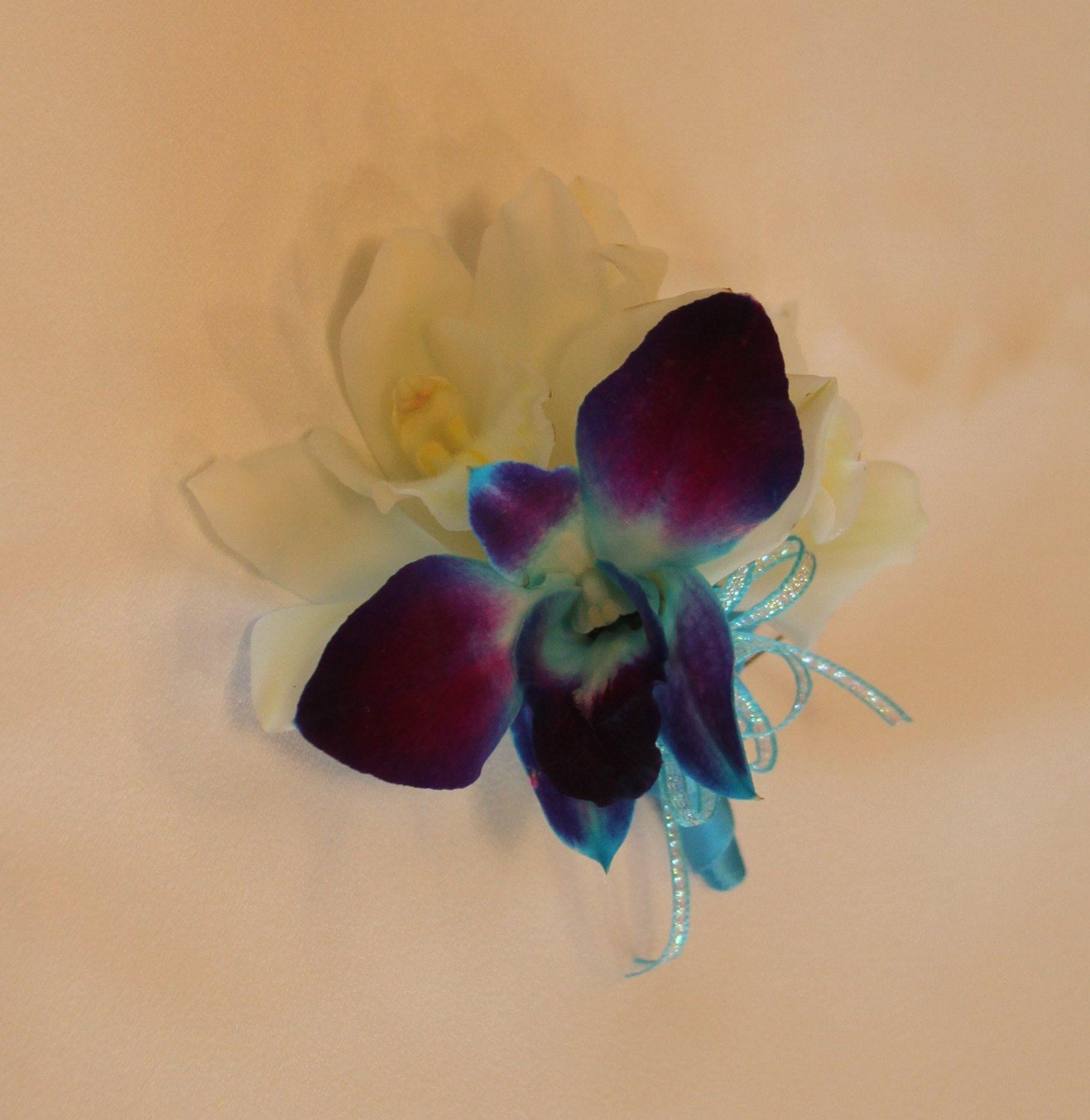 White cymbidium orchids u blue dendrobium orchids boutonniere terra