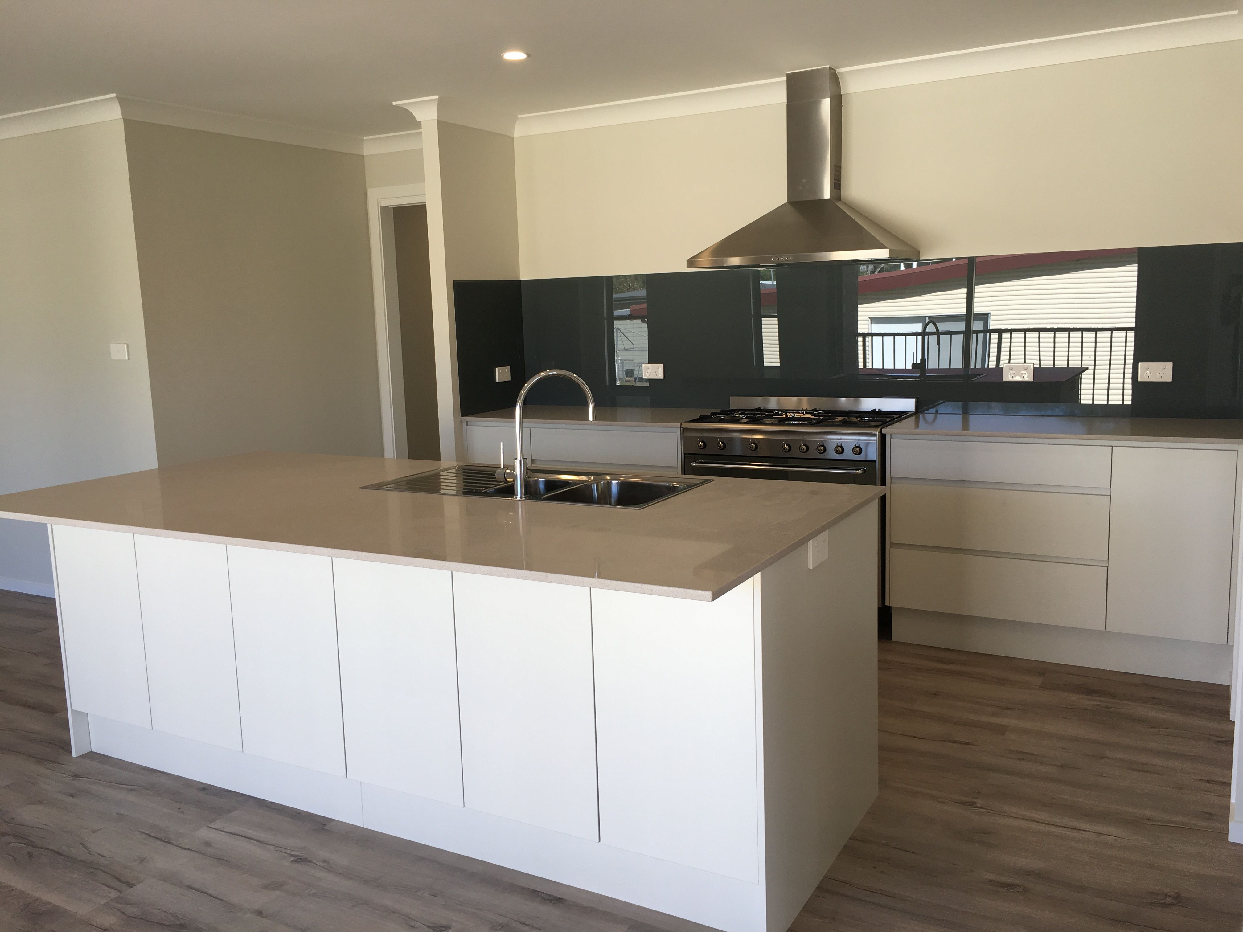 Custom Kitchen Fit Out With No Overhead Cupboards And Glass Splashback Kitchen Remodel Kitchen Fittings Kitchen