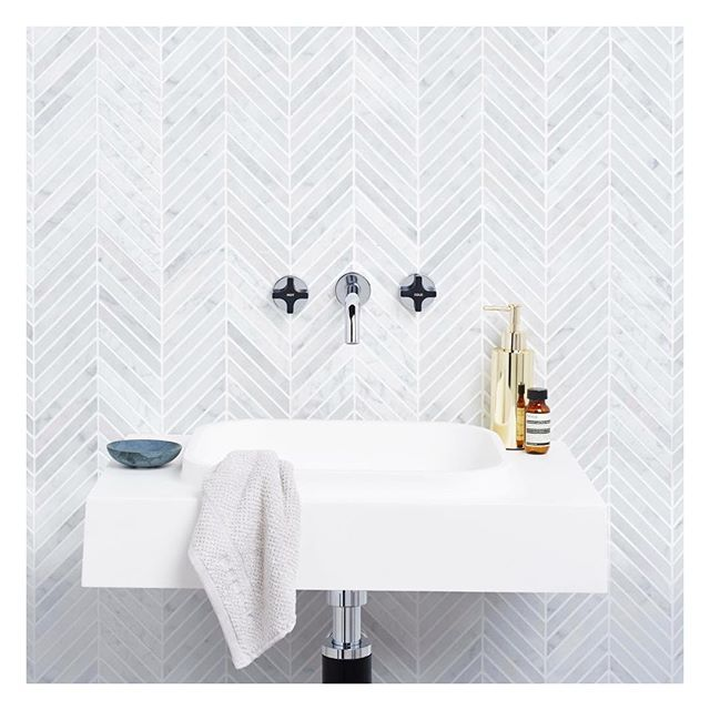Our Carrara chevron mosaics shown with @caromaaustralia sunstone solid surface wall basin right hand shelf  #Carrara #marble #mosaics #honed #luxury #designinspo #design #natural #stone #suppliedby #surfacegalleryaustralia