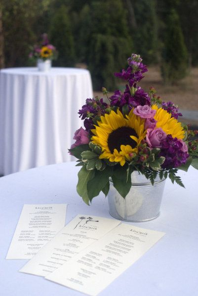 This Is Pretty I Don T Know If I Like Sunflowers With Other Purple Flowers Or Sunflowers With Blue F Sunflower Wedding Wedding Flowers Sunflower Centerpieces