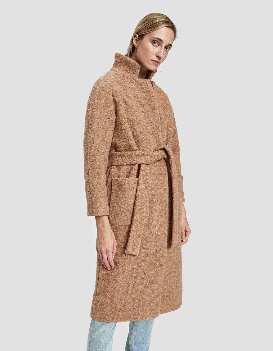 1e1670a38e Overcoat from Ganni in Chanterelle. Textured bouclé knit. Notch lapel. Dual  snap button closure at waist. Removable tie belt. Front patch pockets.