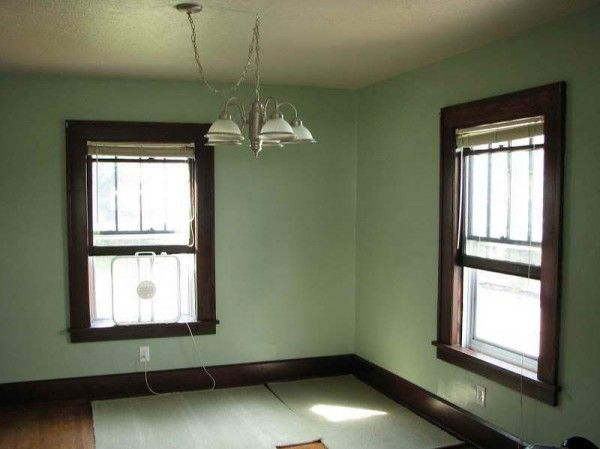 Blue Green Wall Color with Dark Stained Trim
