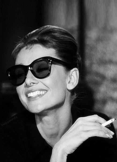 5c1cd56b1c9b Audrey Hepburn in Breakfast at Tiffany s - rocking cat eye sunglasses.