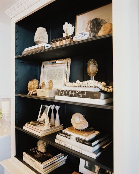 styling steps: 1. Empty shelves 2. Gather your decorative knickknacks 3. Sort books by color 4. Add small groups of books to the shelves (8-10) 5. Change it up: orient some stacked side to side & some stacked one on top of the other 6. After stacking books, bring on the knickknacks 7. Adjust until it feels right