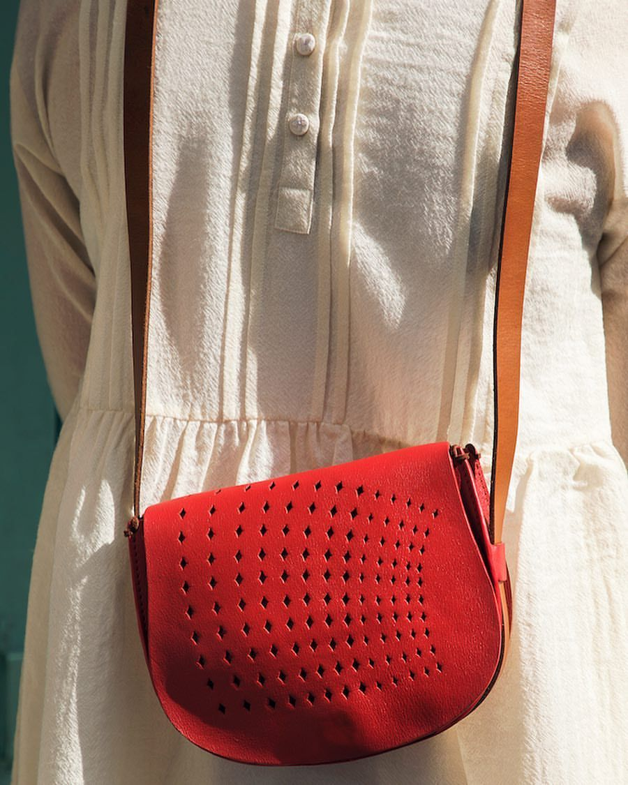 Our summer ivories look chicer when paired with #Vitasta's minimalist leather bags. Find them at our - ogaanindia