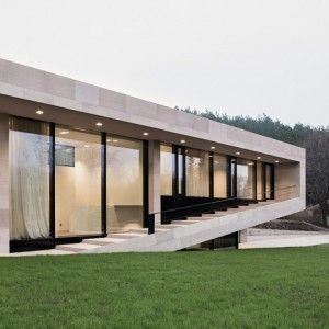 Stone house in Bulgaria by I/O Architects features a veranda that ...