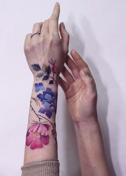 Ann Lilya flower tattoo