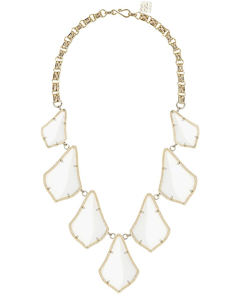 Embrace the warmth of a free-spirited summer in this perfectly bohemian statement necklace, featuring classic white stones in a Moroccan inspired silhouette for a light, fresh flair.
