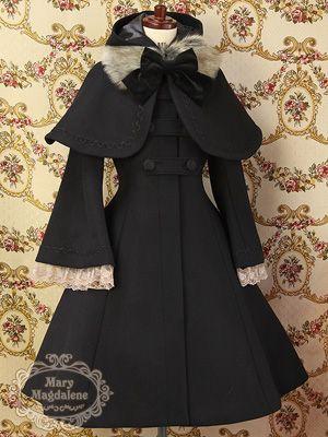 Schwarzer Mantel, schwarze Schleife, Pelz