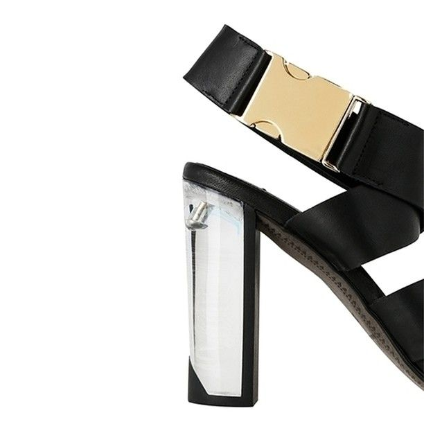 e230d066671 Get your party season look nailed down with the gorgeous Miista Sian Heel a  black leather strapped shoe with clear heel and gold buckle.