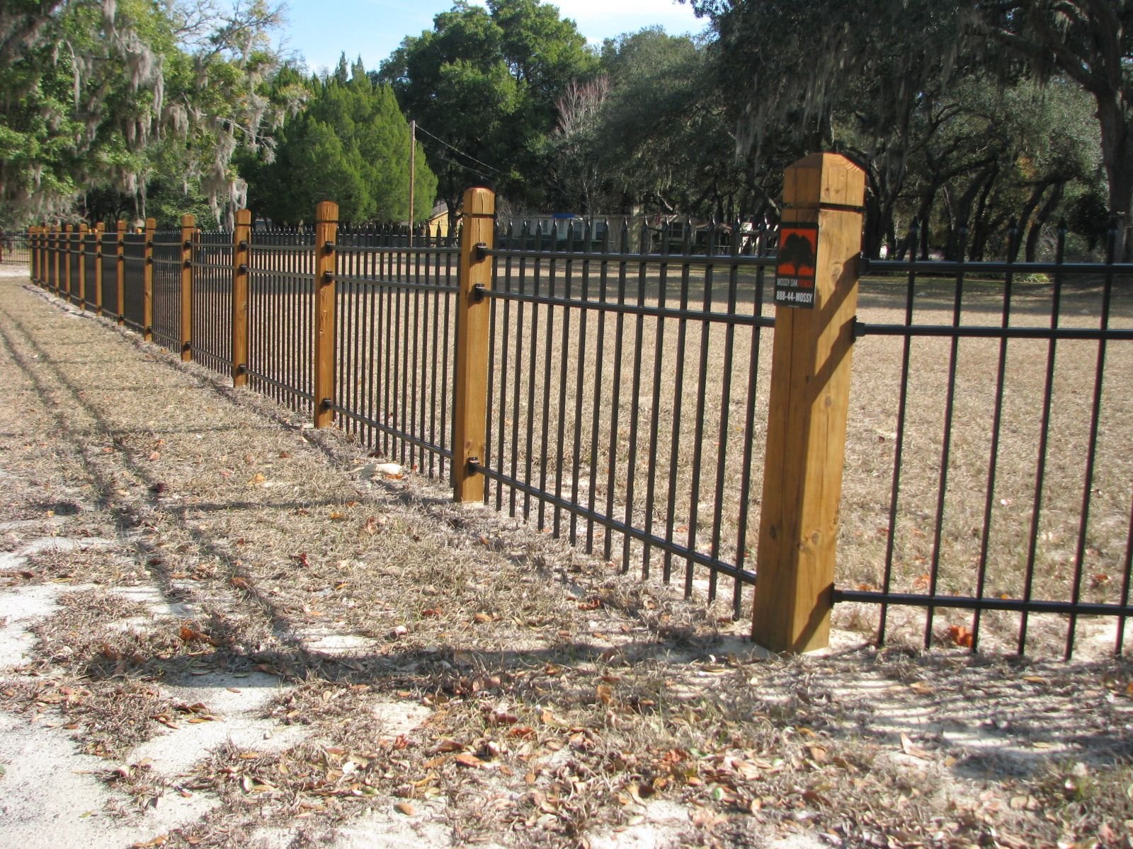 Specialty Fence Design By Mossy Oak Fence Company In Orlando And Melbourne Fl Wood Stained Posts Aluminum F Fence Design Building A Fence Fence Around Pool