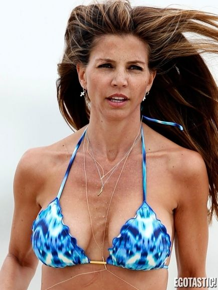 Charisma carpenter in a black bikini