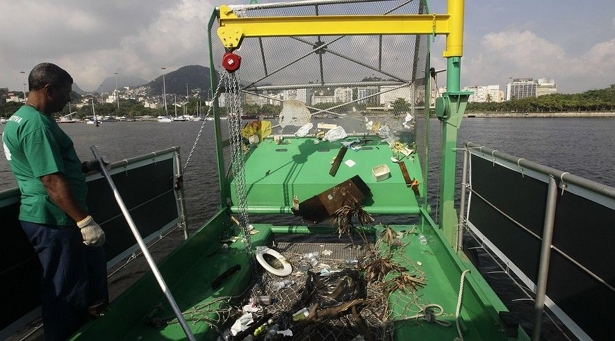 Newsela | Boats go fishing for trash in Rio's big bay