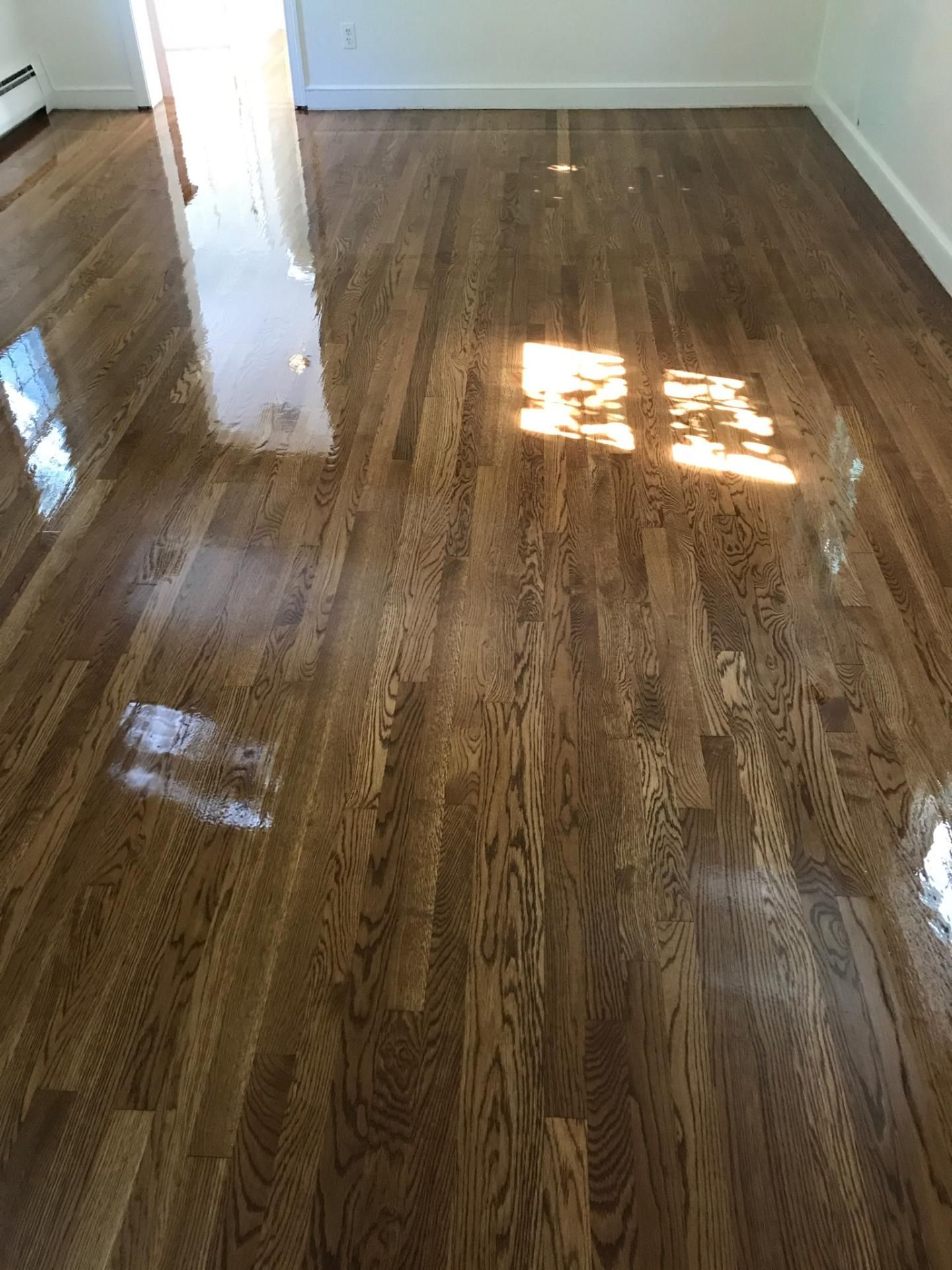 We recently refinished these white oak hardwood floors! We ...