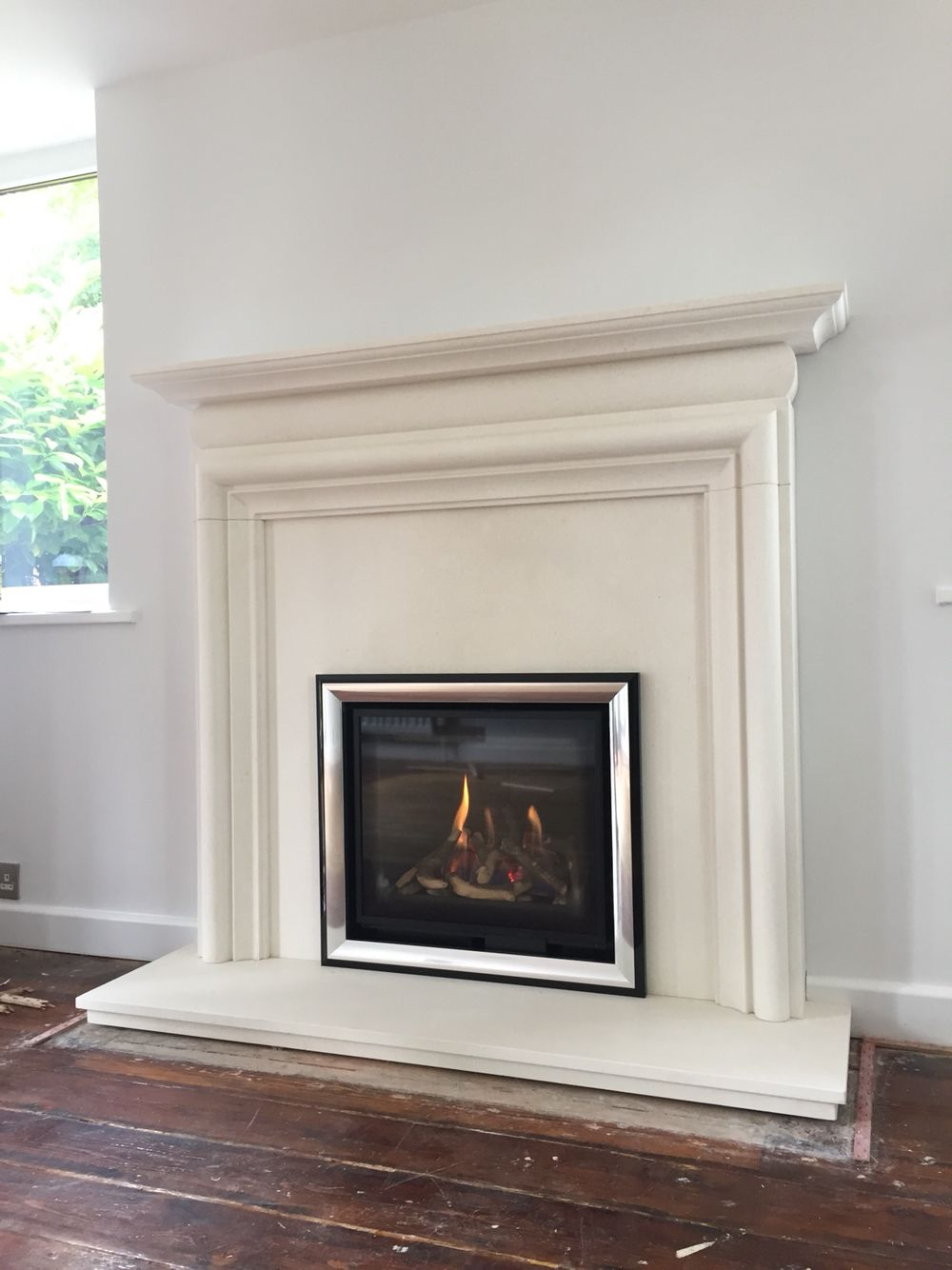 Asquith fireplace in agean limestone with matching back