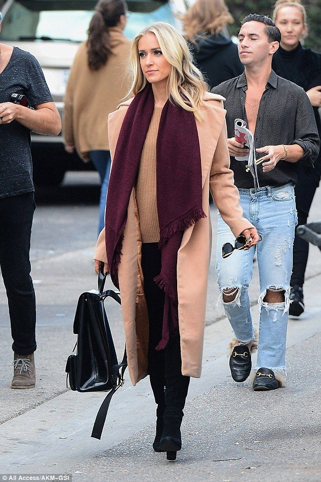b6f71e95c0f Stylish  The 29-year-old reality television star layered an elegant nude  long coat over a matching sweater