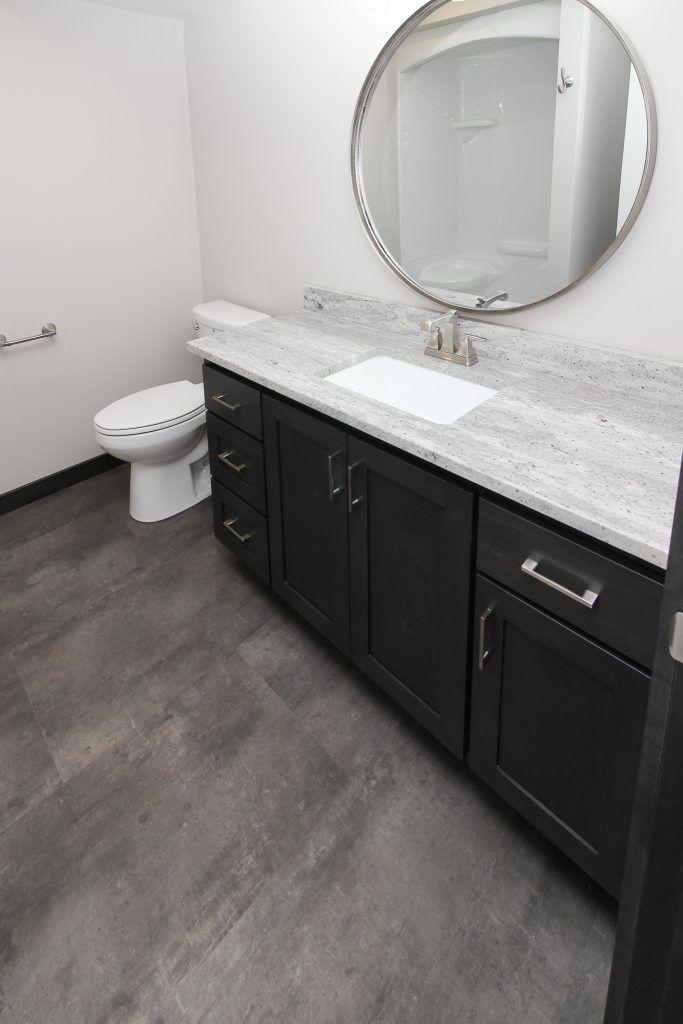 Dark Gray Luxury Vinyl Tile Bathroom Floor (With images ...