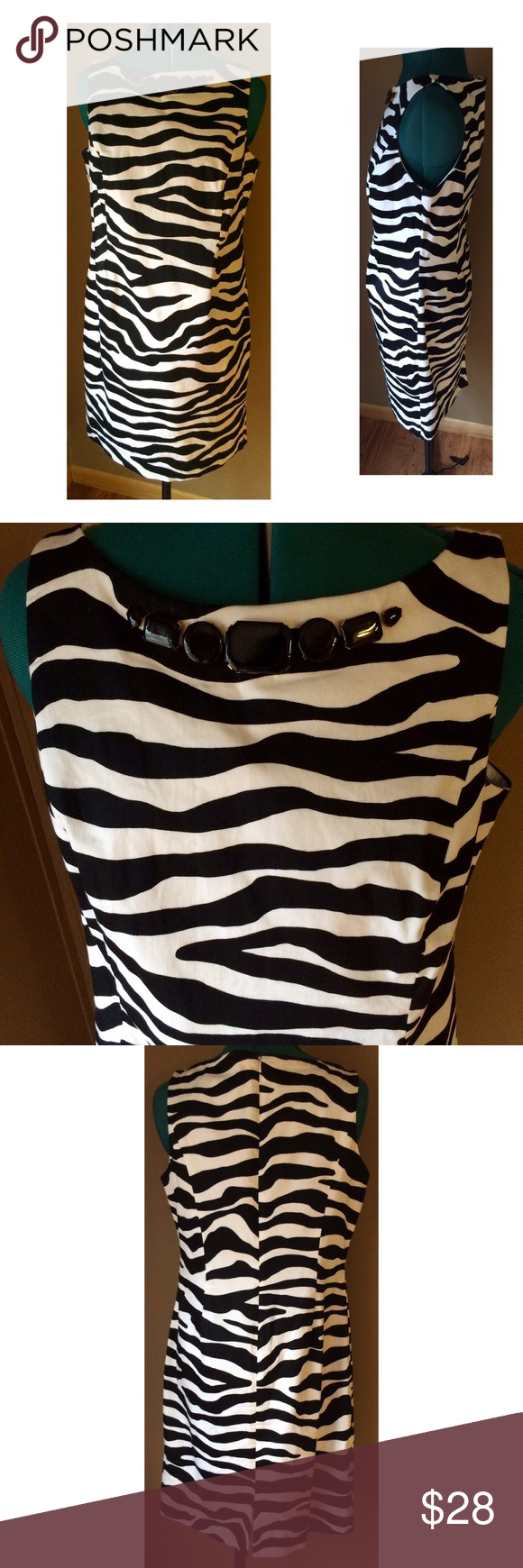 "Jones NY Zebra Print Beaded Shift Dress Black and white zebra print shift dress from Jones New York.  Features a ""necklace style"" big beaded accent at neckline.  Fitted at the waist and zips up the back.  Fully lined. Condition: good used condition - gently worn, free of rips, stains, odors. Material: Cotton/Spandex with Polyester lining Size: L Pit to Pit: 20"" with stretch available Waist: 35"" (natural) Hips: 40"" Length: 37"" Jones New York Dresses"